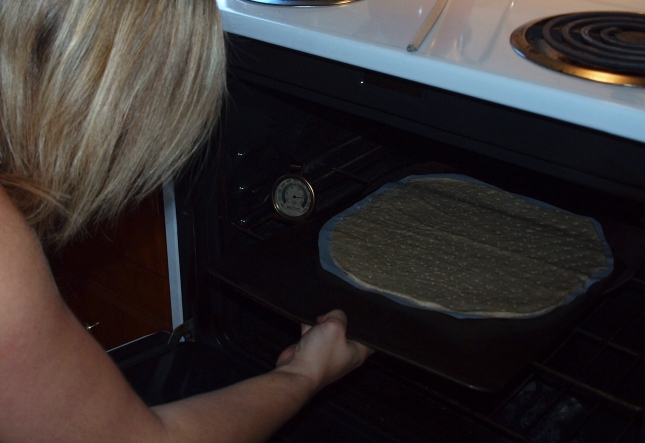 Slide Homemade Pizza Dough into Oven Using Flat Cookie Sheet