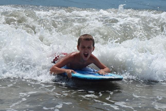 My boy boogie boarding the day away!